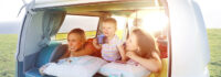 Two woman and toddler in the back of a camper van